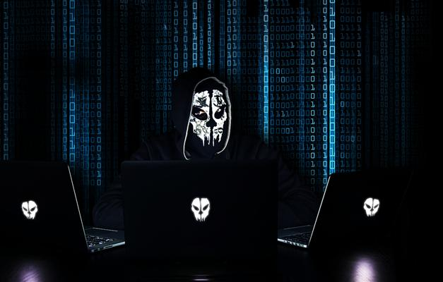 Computer hacker wearing a mask