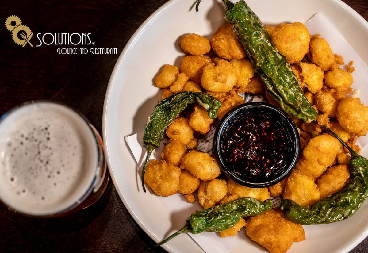 A Larimer Square restaurant favorite: Cheese curds and shishitos